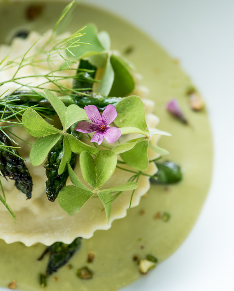 Crab ravioli in an asparagus and pistachio avgolemono