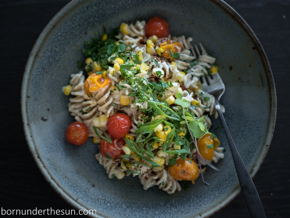 Sumac spiced goat cheese pasta with sweet corn and blisteredtomatoes