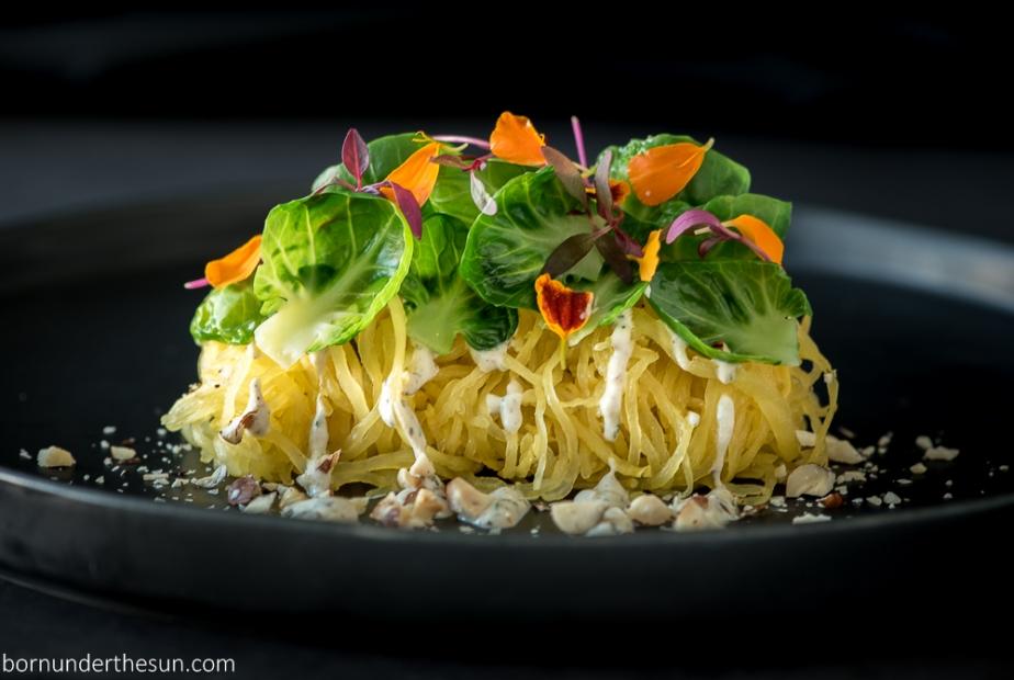 Spaghetti squash with mushroom cashew alfredo, brussels andhazelnuts